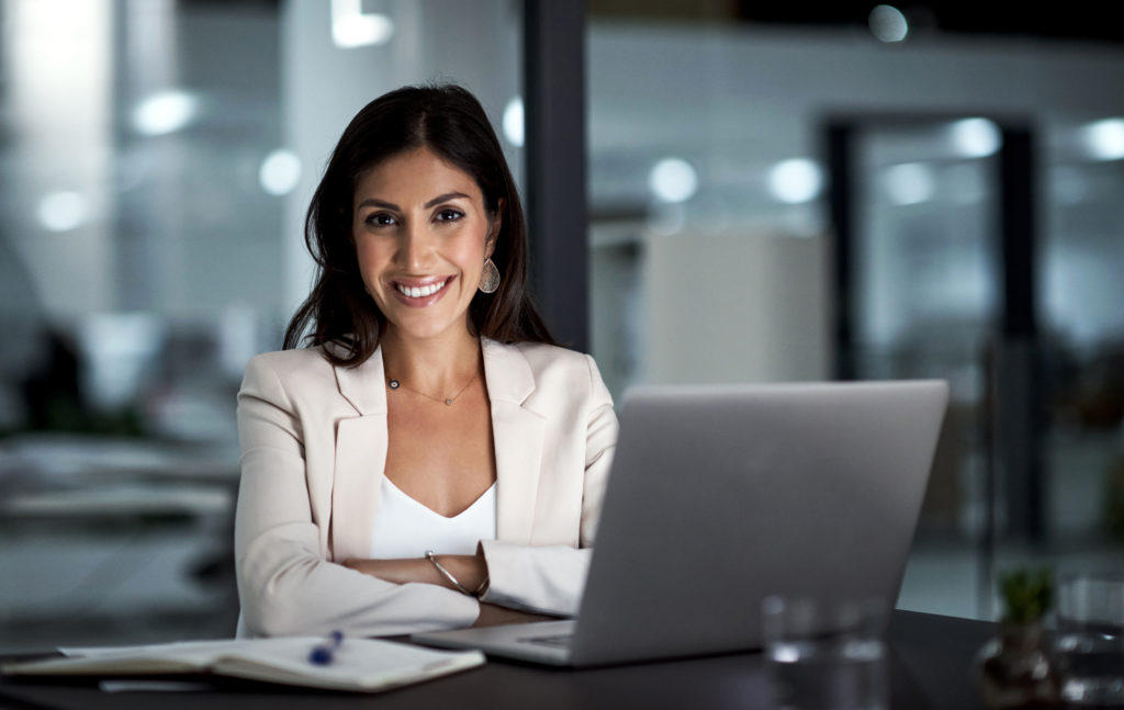 woman on laptop with a lead generation mindset